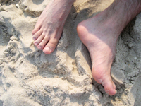mens toes in sand